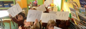Children holding signs with writing